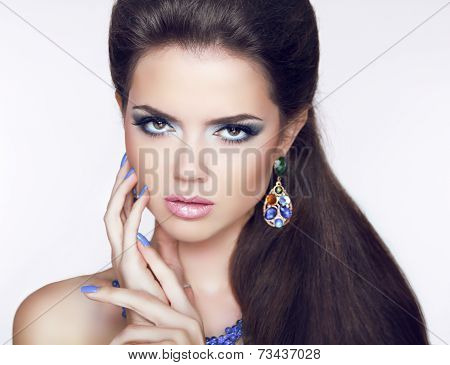 Beautiful Brunette Young Woman With Fashion Earring. Makeup. Manicured Nails. Long Hair.