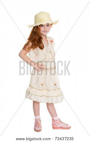 Little fashionista in a summer dress and hat. Girl is six years.