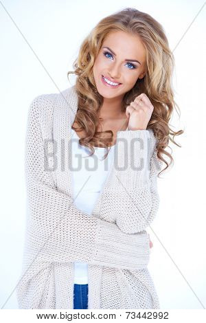 Portrait of Smiling Blond Woman Wearing Cozy Sweater Cardigan in Studio