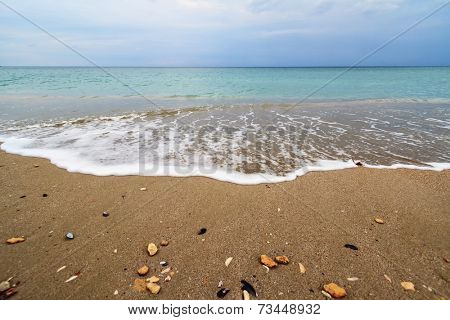 Wave of the sea on the sand tropical beach