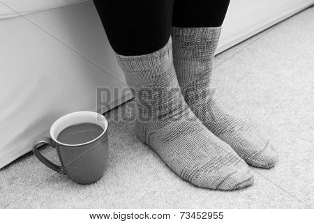 Hot Drink On The Floor By Feet In Socks