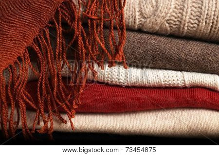 Pile of Woolen Sweaters and a Scarf