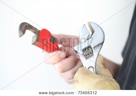 Workman with two wrenches