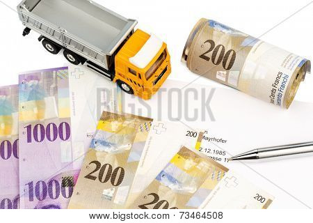 the purchase contract for a new truck at a swiss car dealer. with swiss francs.