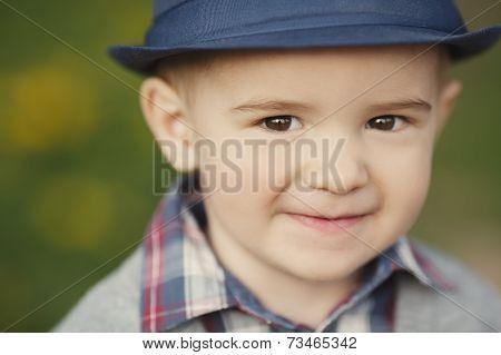 little boy with hat portrait
