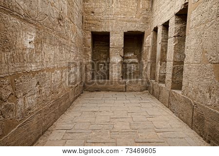 Egyptian hieroglyphic carvings in a chamber at the temple of Medinat Habu in Luxor