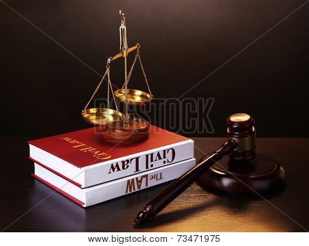 Books of Law on table on grey background