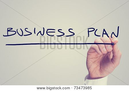 Hand Writing Business Plan On A Virtual Screen