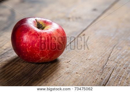 red apple on wooden background