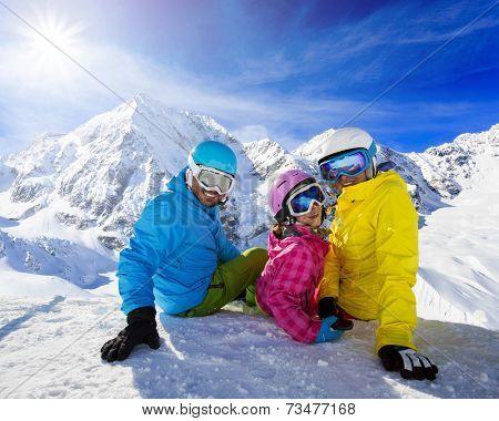Skiing, winter, snow, skiers - family enjoying winter vacations