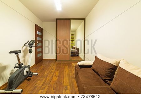White and brown bedroom with wooden floor