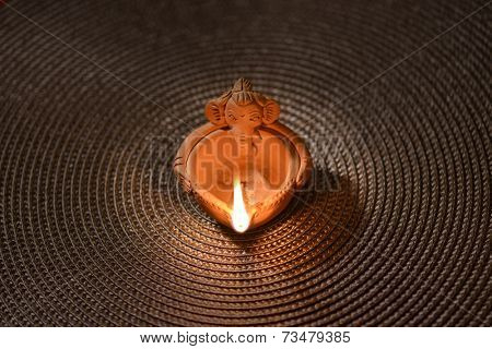 A traditional Indian lamp made with  terracotta in ganesha shape