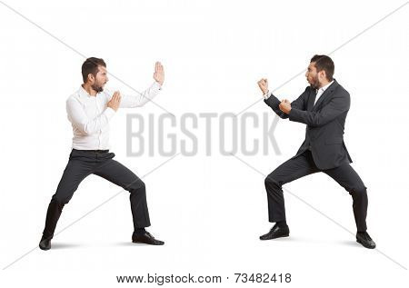 two funny fighters in formal wear over white background
