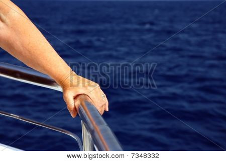 man hand holding the holder on boat deck