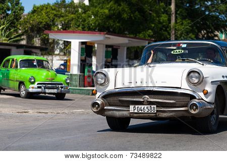 HAVANA,CUBA - June 27, 2014: White and green classic car on the road in havana