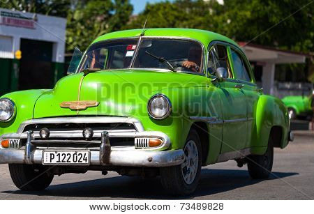 HAVANA,CUBA - June 27, 2014: Green classic car on the road in cuba