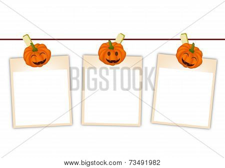 Blank Photos with Halloween Pumpkin Hanging on Clothesline