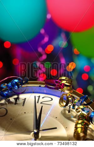 New year party decoration with balloons and clock close to midnight