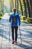 stock photo of pole  - Nordic walking adventure and exercising concept  - JPG