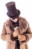 image of hustler  - a young man wearing a sheepskin coat and a top hat isolated over a white background holding banknotes - JPG
