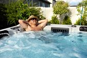pic of tub  - Man having massage in  hot tub Jacuzzi - JPG