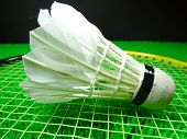 foto of shuttlecock  - shuttlecock on a badminton racket close up - JPG