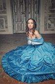 picture of pompous  - Young beautiful medieval woman in long blue dress praying - JPG