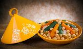 foto of dialect  - Vegetable Tajine with cous cous on wooden table - JPG
