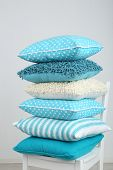 picture of puffy  - Bright pillows on chair in room - JPG