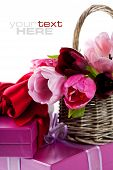 stock photo of gift basket  - Pink tulips and gift boxes on a white background - JPG