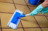 pic of broom  - cleaning a floor with a broom and bucket - JPG