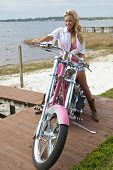 Sexy Blond Woman In Bikini And Shorts On Chopper Motorbike