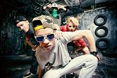 stock photo of break-dance  - Modern dancers dancing in the garage - JPG