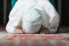 image of muslim  - Young Muslim Woman Praying In Mosque  - JPG
