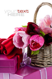 foto of gift basket  - Pink tulips and gift boxes on a white background - JPG