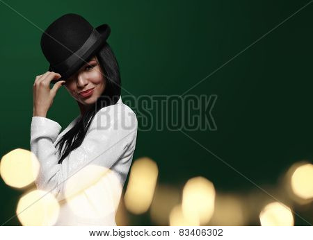 Elegant Woman In Hat, On A Green Background With Bokeh