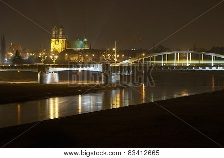 River Warta, bridge and cathedral at night