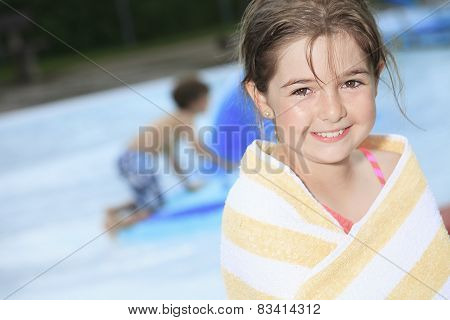 Child play at the pool place in a beautifull summer