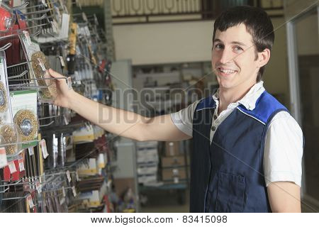 A sales assistant portrait in home appliance shop supermarket st