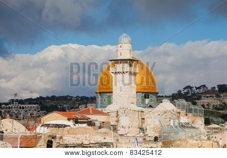 Minaret And Dome Of The Rock Against Cloudy Sky