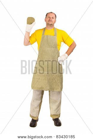 Welder with protective gloves and apron.