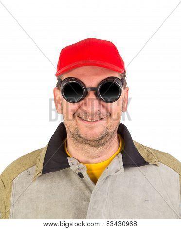 Smiling welder in glasses.