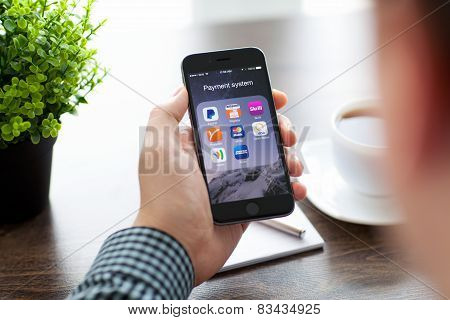 Businessman Holding iPhone 6 With Payment Apps