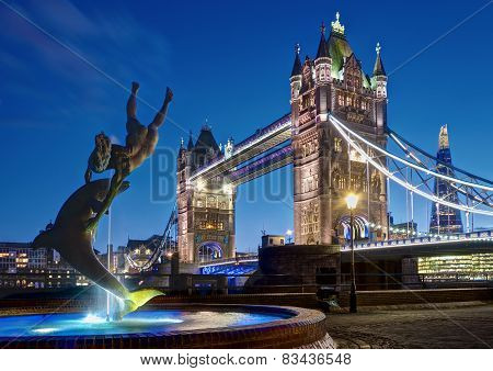 London UK - February 26 2014: Picture Tower Bridge with the Girl with a Dolphin sculpture by David W