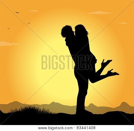 silhouette of lovers in the sunset