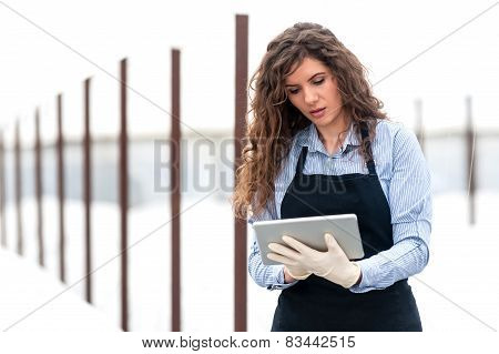 Female researcher technician studying with a tablet