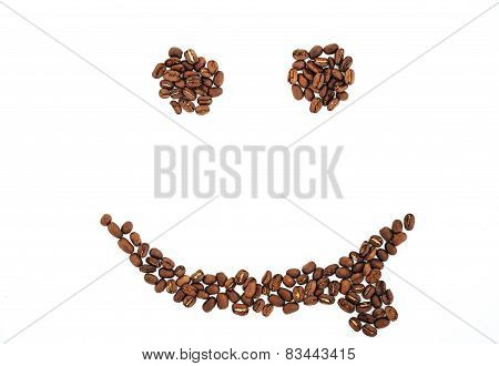 Grains of coffee in the form of smiling face isolated. coffee beans isolated on white background. ro