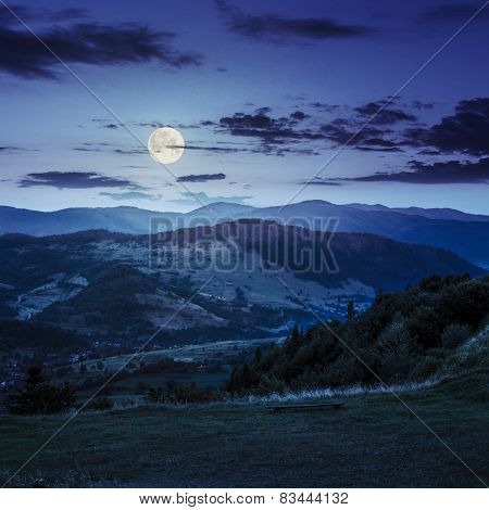 Village Near Forest In High Mountains At Night