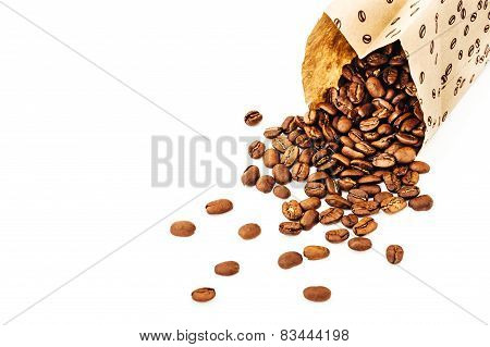 Paper bag with grain coffee on white background. coffee beans isolated on white background. roasted