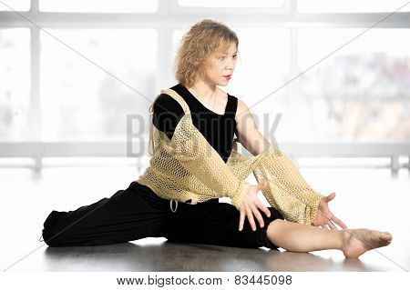 Beautiful Dancer Female Sitting In Half-split Position